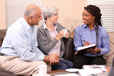 Senior adult couple meets with financial advisor