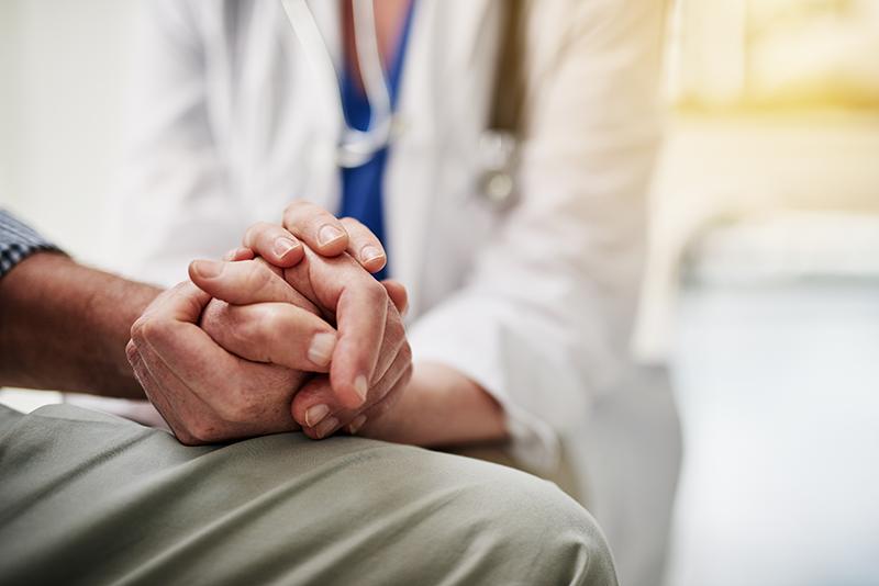 doctor-holding-hand-of-elderly-man