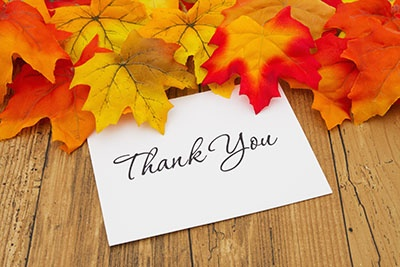 Autumn Leaves on weathered grunge wood with a Thank You Card.jpg