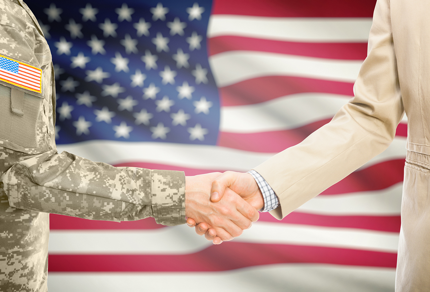 veteran shaking hands with businessman